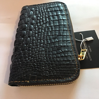 This is a genuine Crocodile ladies Purse.They all have the Buffalo interior and are large enough to...