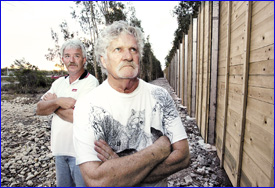 Sound argument: Steve Bayley and Nev Geddes are unimpressed with the new sound barrier at Mooloolaba. Photo:Chris McCormack