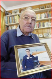 Charlie Brown holds a photo of his pilot son, now based in Canberra. Picture: BEV LACEY