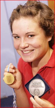 Toowoomba rower Sally Kehoe shows off her world rowing championship medals. Picture: KEVIN FARMER