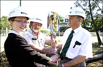 Lismore Mayor Merv King is handeda a spade to turn the first sod for the Square?s extensions.