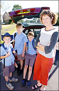 MORE FUNDS PLEASE: Leonie and her sons Andrew, 8, left, Patrick, 12, centre, and Thomas, 10.