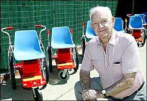 WHEELY GOOD: Tugun resident Jim Bullen with wheelchairs he made for the Rotary Wheelchair Program