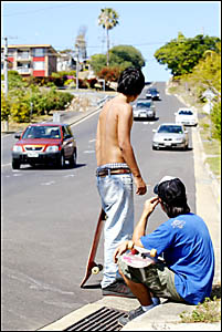 Skateboarders at the scene of Saturday night?s fatality in Tweed Street, Coolangatta