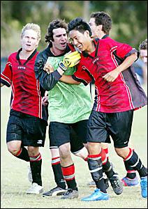 TWO-GOAL hero Kenta Shimizu (right) is congratulated by Burringbar goalkeeper Dave Lee