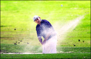 UP AND DOWN: Ray Darragh, of Beaudesert, blasts out of a sandtrap during the Lismore Pro-Am yesterday