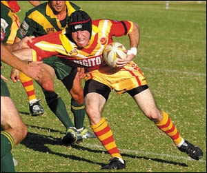 Coffs Harbour Comets fullback Mark Pledger tries to poach another try during the 2004 VB Group 2 season