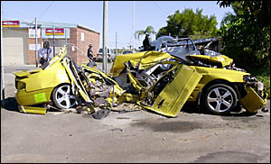 EXPLOSIVE IMPACT: The mangled wreckage of the Ford Falcon XR8