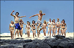 FABULOUS FEELING: Models try out for a spot in the Coca-Cola beach advertisement at Shelly Beach, Ballina, yesterday.