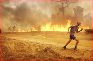 Chronicle photographer SCOTT FLETCHER captured this image as he and volunteer firefighters fled a fire at Iredale.