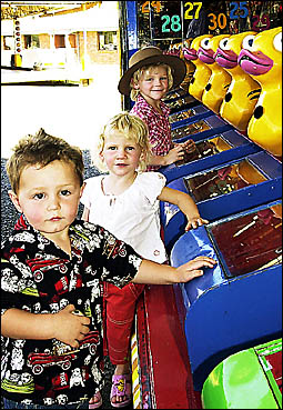 NOT SHY: Having fun at the show are, left, Jacob O?Reilly, 2, Gemma Graham, 2, and Tegan Graham, 5, of Kyogle.