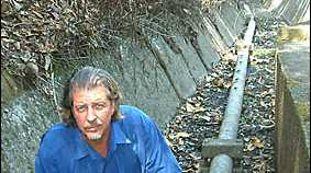 DRY TIMES: Peter Rees, of Byron Shire Council, inspects a dry race at Lavery?s Gap dam