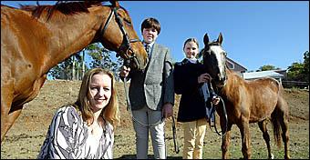 Judge Farren Moten, Matthew Cartwright, 14, with Spirit and Elissa Cartwright, 12, with Ben.