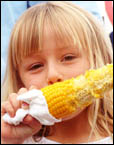 Jazmin Lewsam, 6, of Newcastle, getting stuck into a corn cob at Sunday?s Taste of Byron.