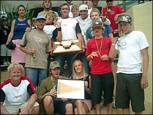 Members of the Byron Bay Boardriders team celebrate their Straddie Assault victory