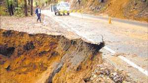 Dorrigo Mountain Road was cut yesterday by this huge washaway.