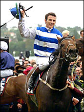 MEMORABLE MOMENT: Jockey Scott Seamer returns to scale on Ethereal after winning the 2001 Melbourne Cup at Flemington.