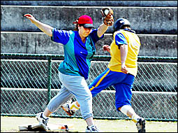 MICHELLE Eggins guards base for Murwillumbah as Sue Turner tries to steal a run for Arkedas in their match won by Arkedas 12-6.