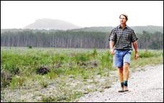 Property owner Jay Chandler walks past his former caneland at Coolum.