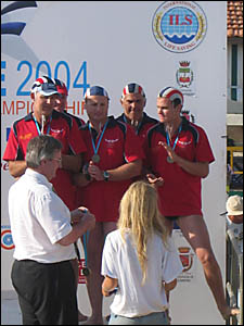 The masters team is pictured receiving their bronze medal.