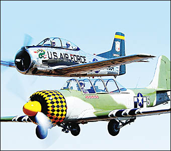 The T-28 Trojan and Yak 52, which will both be coming to Evans Head for the Great Eastern Fly-In which begins December 30.
