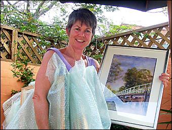 Art show registrar Maggie Golightly taking delivery of an en- try by Byron Bay artist ShirleySchultz.