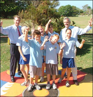 TWEED MP Neville Newell joins Kingscliff Public School student councillorsin celebrating additional funding for the school