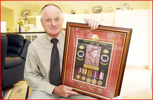 Ken Orford, with his uncle?s World War II medals. Picture: KEVIN FARMER?