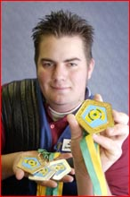 Daniel Eiser with some of his  medals. Picture: NEVILLE MADSEN