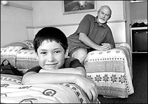 John Rixon and his son Ben, 11, relax in the safety while they wait for tests for asbestos to be returned.