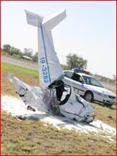 Ultralight crash lands at Roma airport.