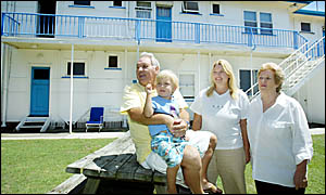 GRAHAM and Julie Nicholls with daughter Brooke and three-year-old grandson Bede at the Carolina Holiday Flats