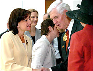 MEMBER for Richmond, Justine Elliot (left), is congratulated by Governor General Michael Jeffery