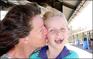 Chloe Timms gets a congratulatory kiss from mum Mara, after her star turn