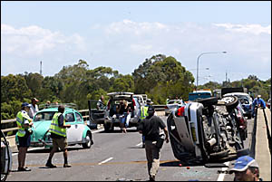 THE trail of damage left after a semi trailer crashed into cars on the Tweed Bypass yesterday morning.