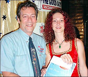 IDOL MANIA: Gary Fox, of The Good Guys, Ballina, presents local Idol winner Vanessa Hoffman with her prizes.