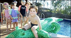 5-Y-O Benjamin Murray shares his pool with friends Ashly and Cori Atkinson, Alicia Murray, and Nina and Tim Schwarz.