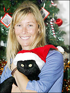 BRINGING Christmas cheer to furry Friends of the Pound animals is Kylie Rogers of Petcare Superstore.