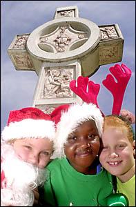 CHRISTMAS SPIRIT: Kody Wilson, Alice Agout and Elena Murray-Prior get into the spirit of Christmas