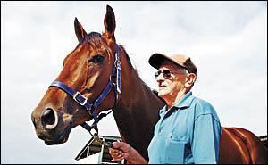 Coffs Harbour trainer Kel Connell with his maiden galloper Secret Money. Photo: CHRISRIX 04120332B