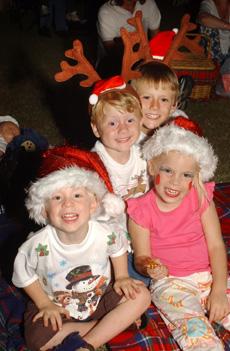 Henry Dahl, 3, Bradley Carr, 3, Michael Carr, 7, and Elise Dahl, 5, enjoyed last night?s Mayor?s Carols by Candlelight.