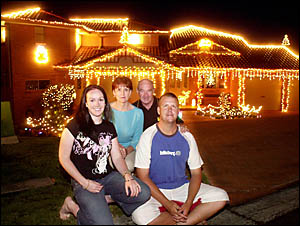 YOU LIGHT UP MY LIFE: Melissa and Adam Thorn, pictured at front, of 53 Trinity Drive, Lismore