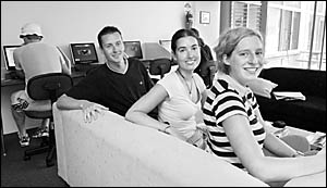 (from left) Patrick Beck, Eveline Moerland and Marloes Hassink settle in to the Coffs Harbour YHA Backpacker Resort.