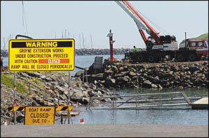 Work going ahead to build the temporary groyne intended to protect the boat ramp.