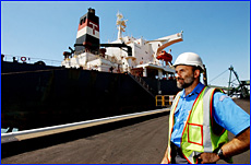 Customs officer Brian Brehmer arrives at the Gladstone coal terminal to inspect newly arrived coal ships.