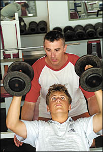 Heath Edwards doing one of his NSW Institute of Sport weights routines under the eye of Jetty Gym proprietor Shane Allison.
