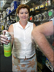 Tanya Maloney of Murwillumbah Disposals shows that using an insect repellent is an effective ways of avoiding mosquitos