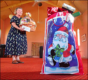 MERRY CHRISTMAS: Denise Williams, a lay preacher with the Anglican Church, delivers goods for the Adopt a Family appeal.
