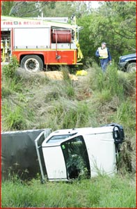 Police and emergency services crews work to retrieve this utility from a ditch.Picture: KEVIN FARMER