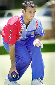 COLOURFUL SIGHT: Trent Craigie, of Sydney, concentrates on his target during play at the Ballina Bowling Club yesterday.